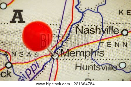 Close-up of a red pushpin on a map of Memphis, USA.