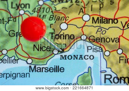 Close-up of a red pushpin on a map of Monaco