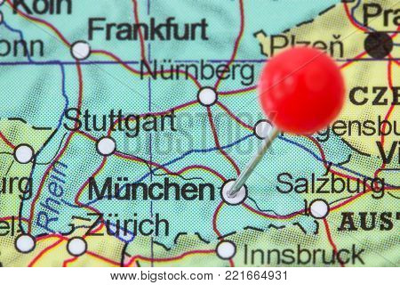 Close-up of a red pushpin in a map of München (Munich), Germany.