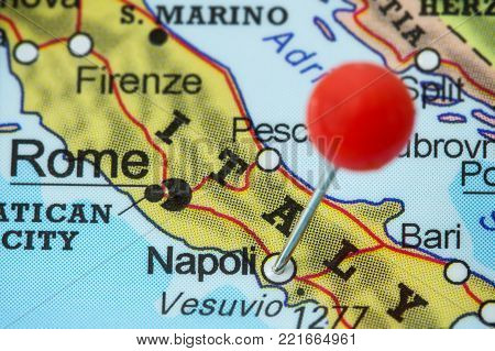 Close-up of a red pushpin in a map of Napoli (Naples), Italy.