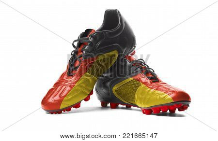 The German flag painted on football boots. Isolated on white background.