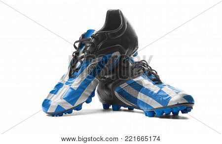 The Greek flag painted on football boots. Isolated on white background.