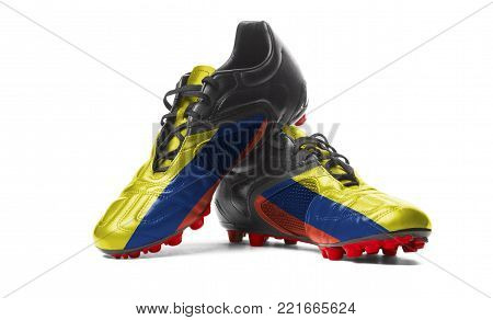 The Colombian flag painted on football boots. Isolated on white background.