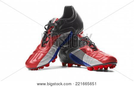 The Costa Rica flag painted on football boots. Isolated on white background.