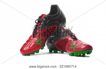The Moroccan flag painted on football boots. Isolated on white background.