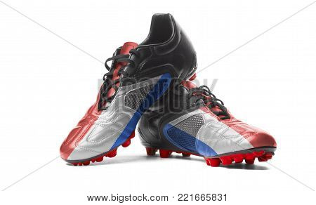 The Netherlands flag painted on football boots. Isolated on white background.