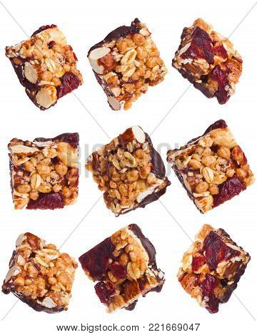 Protein cereal energy mini bars nuts and rasins for breakfast on white background
