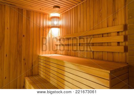 calm, interior, recreation concept. there is a lovely and comfortable background of steam bath with peaceful light and wooden benches that looks like stairs