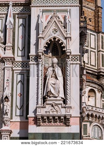 Sculpture of archbishop St. Antoninus at one of the portals of the Duomo in Florence Italy