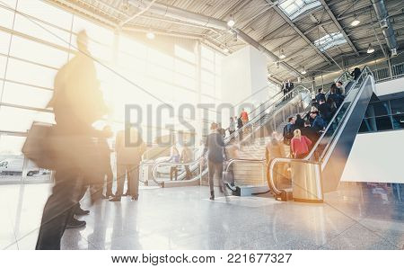 crowd of business people walking in a trade fair hall. ideal for websites and magazines layouts