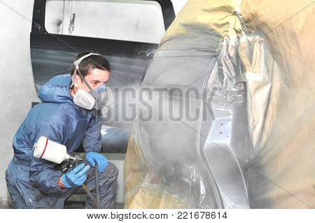 Proffesional car body repair, Painting side panel.