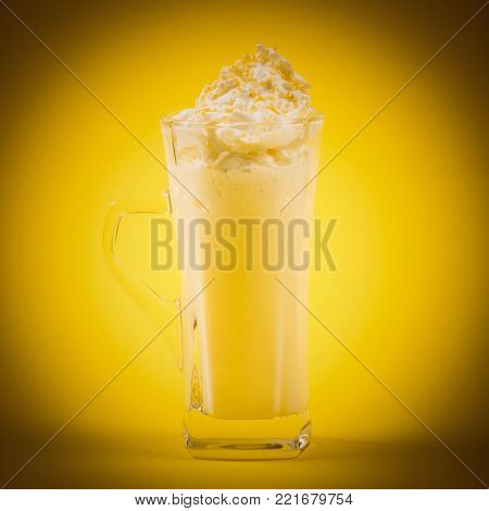 The hot white chocolate drink is on yellow background.