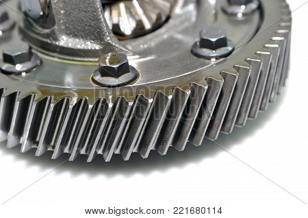 Detail of a car differential on white background.