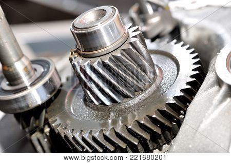 Gears and gearing from a car gearbox.