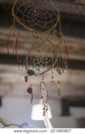 Dreamcatcher. selective focus.Dream catcher hanging on the rope near the ceiling.