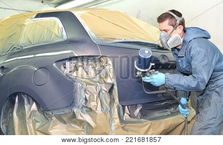 Professional car body painting after body repair.
