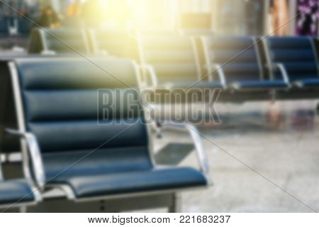 Picture of empty seats in waiting room at airport. blur and Lensflare effect