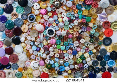 Image on top of many many-colored buttons for clothes