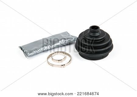 A kit consisting of anther of clamps and a grease bag for replacing anther of CV joints on a white isolated background. Spare parts for car repair