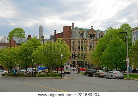 BOSTON - MAY 13, 2014: Charlestown Five Cents Savings Bank, built in 1834, at Thompson Square in Charlestown, Boston, Massachusetts, USA.