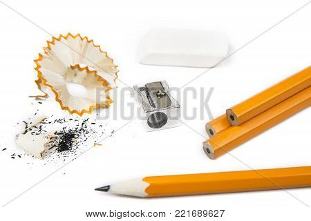 Pencil with pencil shavings and  sharpener with eraser