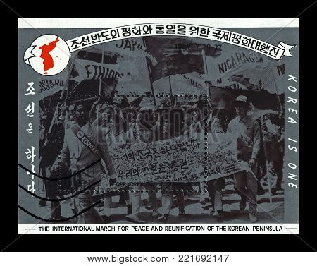 DPR KOREA (NORTH KOREA) - CIRCA 1989: stamp printed in DPR Korea shows International march for peace and reunification of the Korean Peninsula on July 20-27, circa 1989. Korea is one.