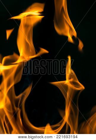 fire on black close up abstract background .