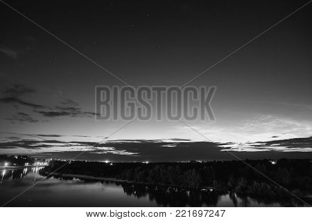 Beautiful night starry landscape. Black and white art monochrome photography. Black and white creative photography. Black and white conceptual image. Beautiful black and white background.
