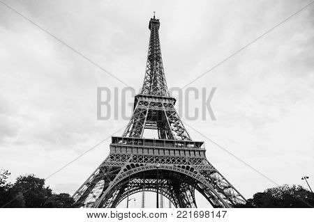 Travel through Europe. Eiffel Tower against the sky in Paris. Black and white art monochrome photography. Black and white creative photography. Black and white conceptual image. Beautiful black and white background.