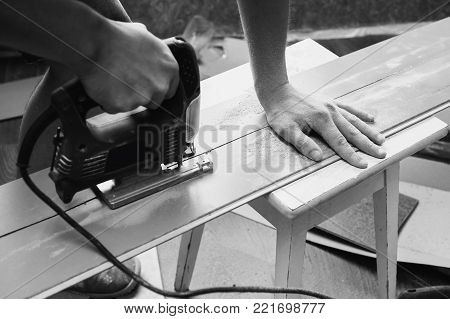 Do makeovers. Sawn board. Make a drawing. Sawdust from a tree. Building tools. Black and white art monochrome photography. Black and white creative photography. Black and white conceptual image. Beautiful black and white background.