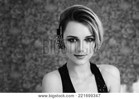 Black and white art monochrome photography. Black and white creative photography. Black and white conceptual image. Beautiful black and white background. Black and white portrait. Lovely girl with tanned skin and white hair listening to music