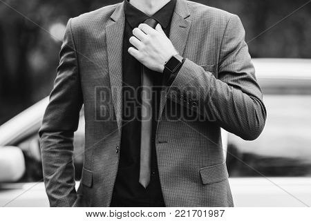 Successful businessman in a dark business suit. Black and white art monochrome photography. Black and white creative photography. Black and white conceptual image. Beautiful black and white background. Black and white portrait.