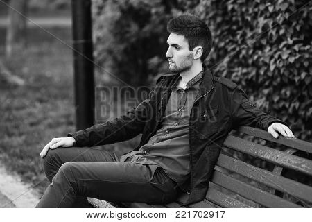 Black and white art monochrome photography. Black and white creative photography. Black and white conceptual image. Beautiful black and white background. Black and white portrait. Young attractive cheerful man with dark hair