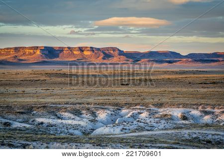 dusk over Pawnee National Grassland in northern Colorado, typical winter or fall scenery with a dry grass