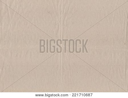 Grunge background with old beige paper with creases and bends.