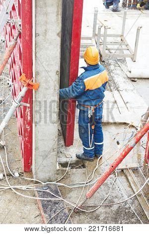 Worker disassemble falsework construction