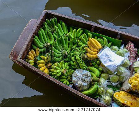 Fresh fruits on boat at Damnoen Saduak Floating Market in Bangkok, Thailand.