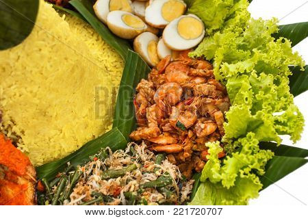 portrait of side dishes on nasi tumpeng, indonesian food