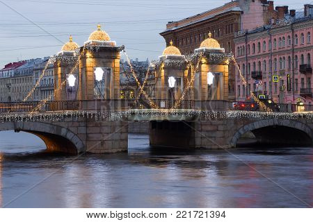 SAINT PETERSBURG, RUSSIA - DECEMBER 18, 2017: Lomonosov Bridge in the New Year's illumination on a cloudy December morning