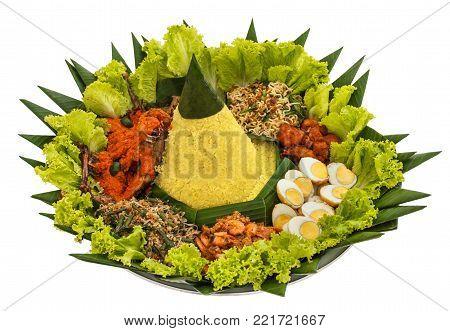 portrait of nasi tumpeng for celebration, indonesian cuisine isolated on white background