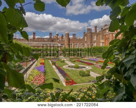 London United Kingdom 07-13-2017 View through a hedge at Hampton Court Palace near London, UK looking towards one of the formal gardens.