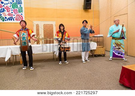 Hokkaido, Japan - 28 December 2017 - Japanese local performers perform traditional local Japanese style music for hotel guests at Eclipse hotel in Hokkaido, Japan on December 28, 2017