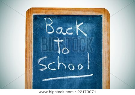 sentence back to school written in a vintage blackboard