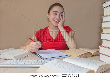 Girl working on his homework. young attractive student Girl studying lessons