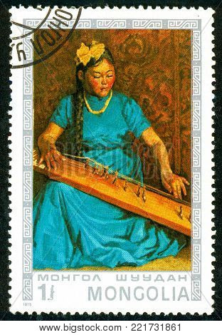 Ukraine - circa 2018: A postage stamp printed in Mongolia shows Woman musician. Stringed plucked musical instrument. Series: Mongolian paintings masterfully. Circa 1975.