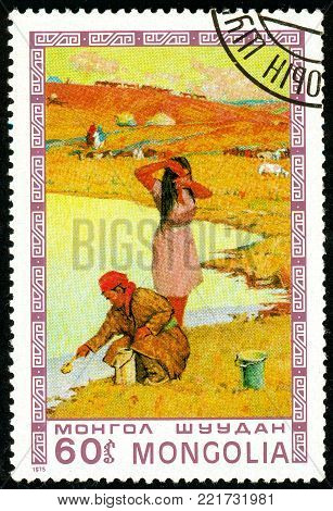 Ukraine - circa 2018: A postage stamp printed in Mongolia shows Woman fetching water. Series: Mongolian paintings masterfully. Circa 1975