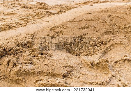 Texture of yellow sand on beach.Small depth of field