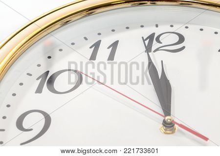 close up of wall clock and time is twelve