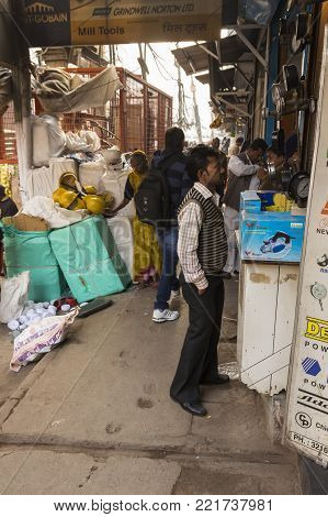 DELHI, INDIA - December 18 2014 :   people in front of hardware store in chawri bazar, this old market is large hardware market of delhi.