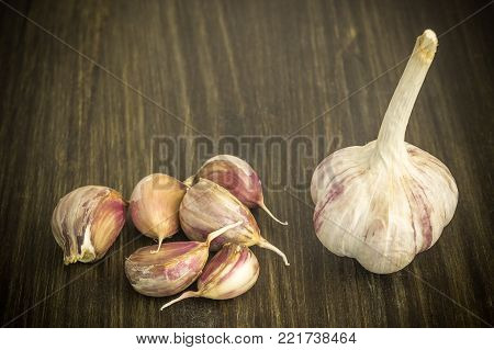 Garlic. Garlic and garlic cloves on the table. Garlic on a wooden table. The concept of a healthy lifestyle.